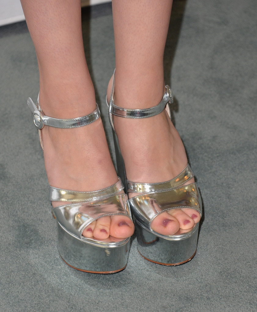 Nicola completed the fresh Beverly Hills ensemble with Prada platform sandals.