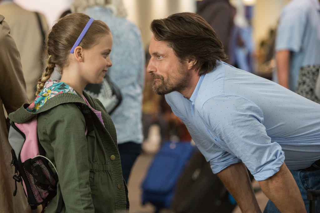 Kevin (MARTIN HENDERSON) says good bye to Anna (KYLIE ROGERS) before she heads for the plane to Boston in Columbia Pictures' MIRACLES FROM HEAVEN.